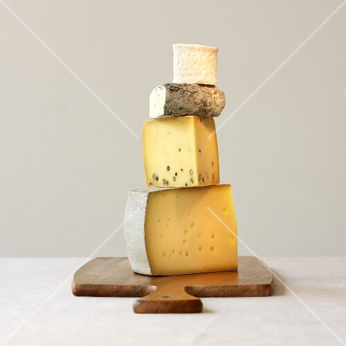 Four varieties of cheese, stacked