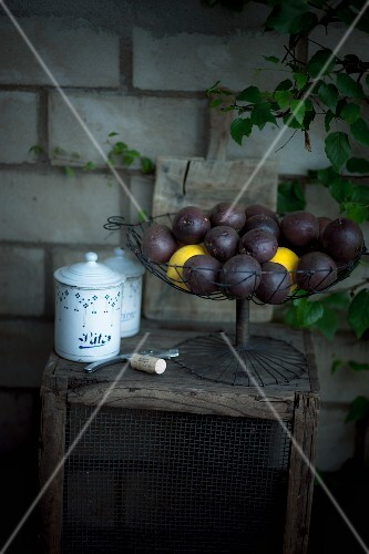 Maracujas and lemons in a wire basket
