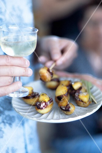 Potato canapes with Bloodwurst and apple, Port and Tonic aperitif