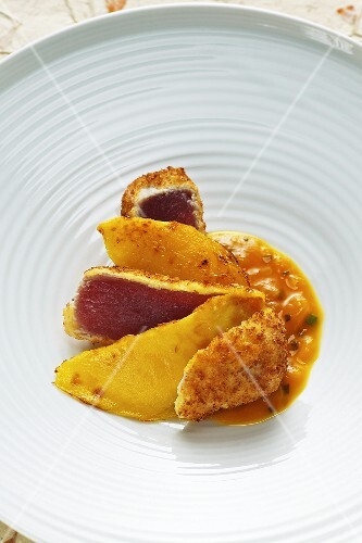 Tuna fish with a coconut coating with roasted mango and mango chutney