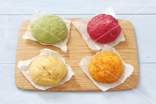 Four types of noodle dough, neutral and colored (with carrots, red beets and spinach)