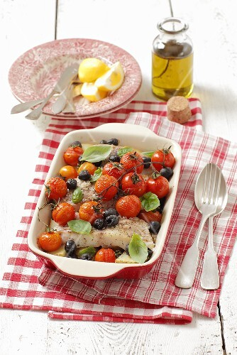Halibut with cherry tomatoes, olives and basil