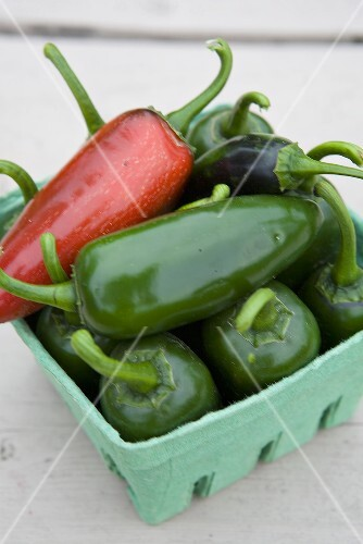 Jalapeno peppers in a cardboard box