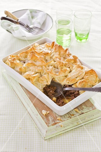 A lamb pie with a puff pastry lid