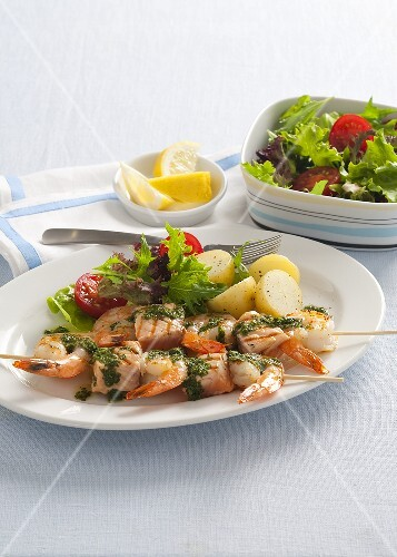 Salmon and prawn kebabs with a side salad
