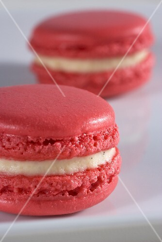 Pink macaroons with vanilla cream