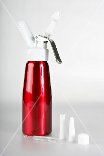 A red soda bottle with various caps