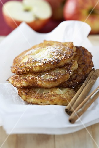 Apple cakes with icing sugar and cinnamon