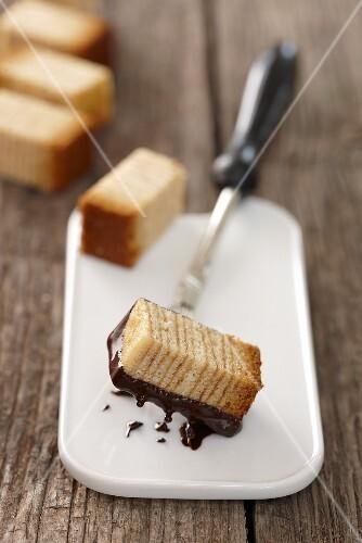 Baumkuchen (German layer cake) with chocolate sauce