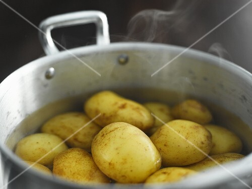 Cooked new potatoes in steaming water