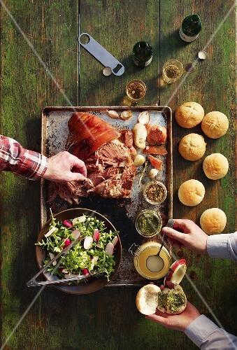 Ingredients for sandwiches (roasted pork shoulder, sauces and salad)