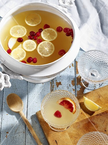 Lemon punch with apples and cranberries