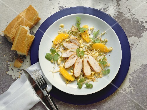 Chicken breast on sprout salad