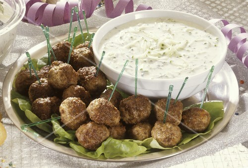 Appetizer platter with meatballs and cucumber dipping sauce