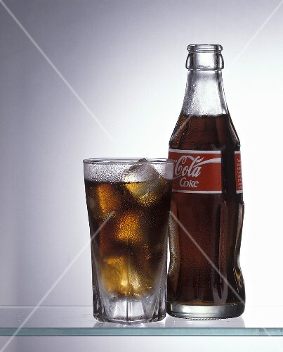 A Cold Glass of Coca Cola with the Bottle