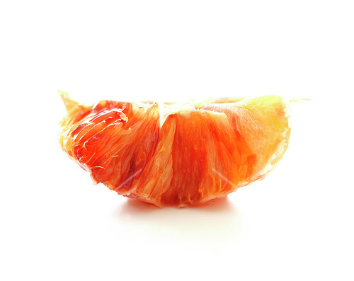 Blood orange segment on a white background