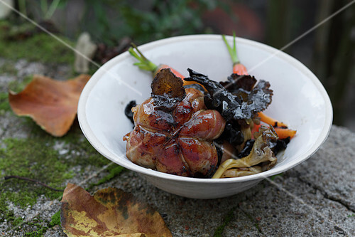 Veal Paupiette wrapped in bacon with wild mushrooms and carrots