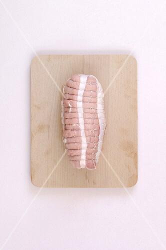 Raw pork roast on a chopping board