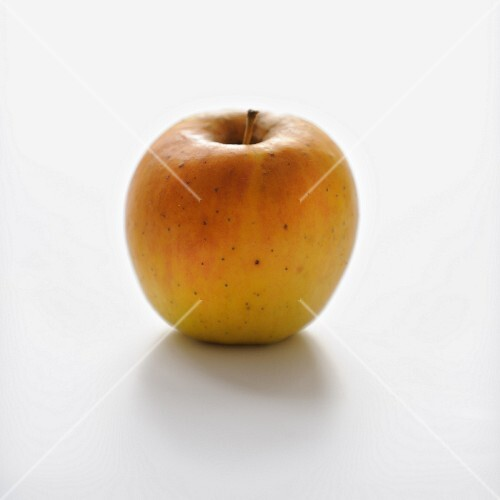 Golden apple on a white background