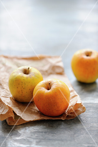 Golden apples and a brown paper bag
