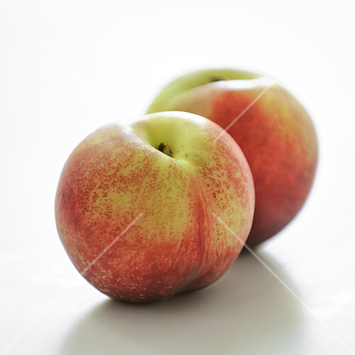 White nectarines on a white background