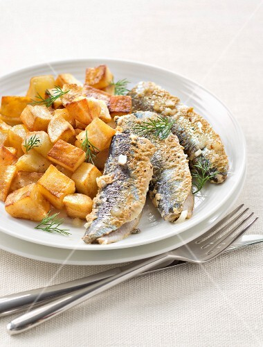 Pan-fried sardines coated in mustard and sauteed potatoes