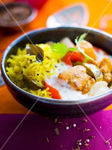 Basmati rice, chicken marinated with herbs and peppers, spicy yoghurt sauce