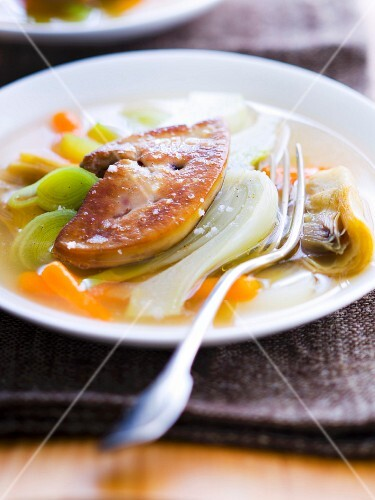 Vegetable broth with pan-fried foie gras