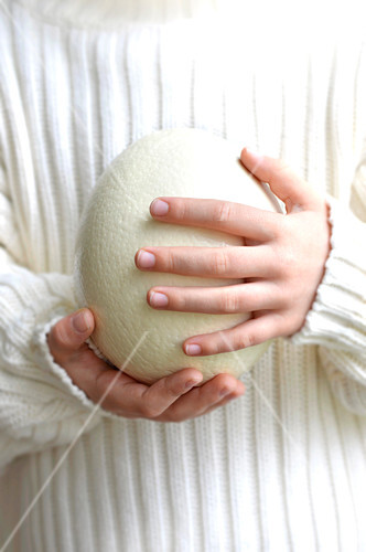 Child holding a white chocolate easter egg