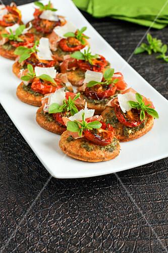 Pesto,confit tomatoes and parmesan bites