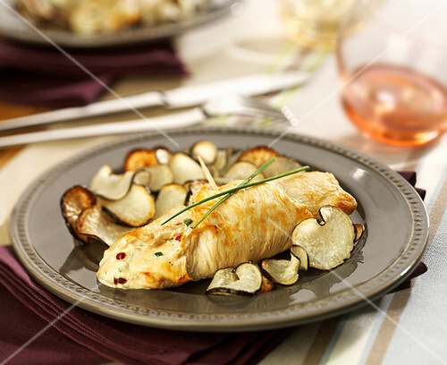 Rolled chicken breast stuffed with fromage frais, pan-fried black radish slices