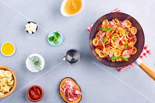 Orecchiette pasta,confit tomatoes, raw ham and basil wok