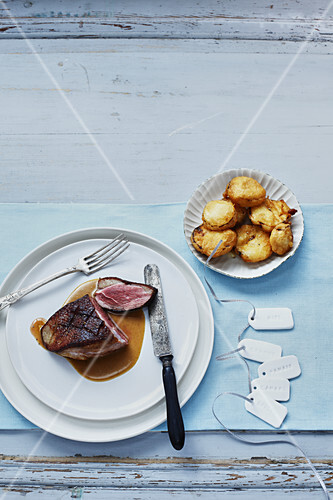 Magret de canard and Pommes soufflées