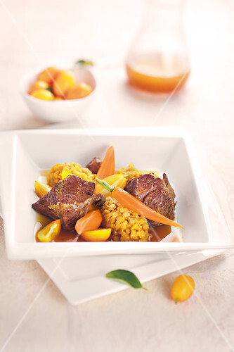 Beef,carrot,yellow cherry tomato and orange lentil stew