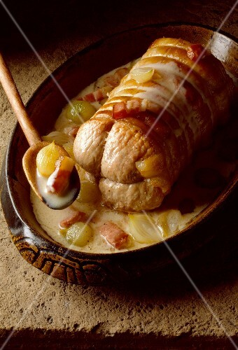 Roast veal roulade wrapped in bacon with a creamy sauce