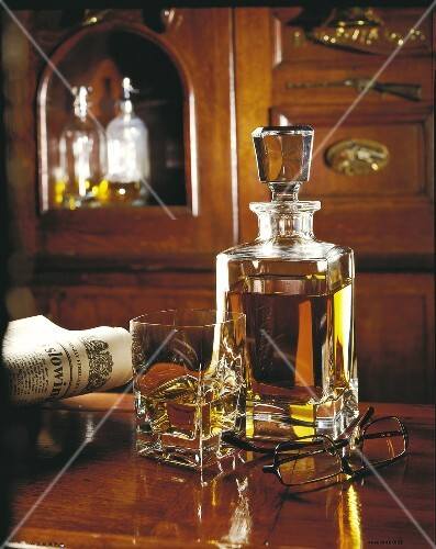 glass of whisky and carafe of whisky