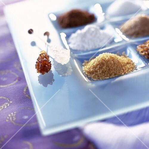Powdered white sugar, brown sugar and light brown sugar