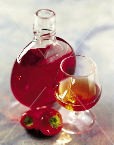 carafe and glass of strawberry liqueur