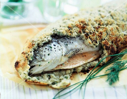 A whole salmon in a salt coating