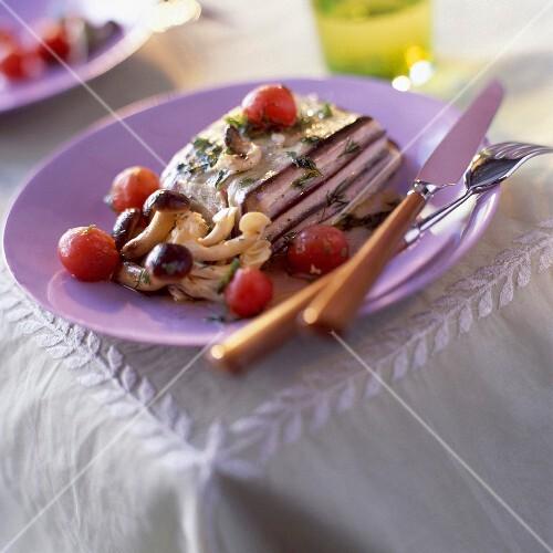 Layered aubergine and swordfish