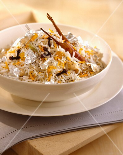 Rice with spices and silver leaves