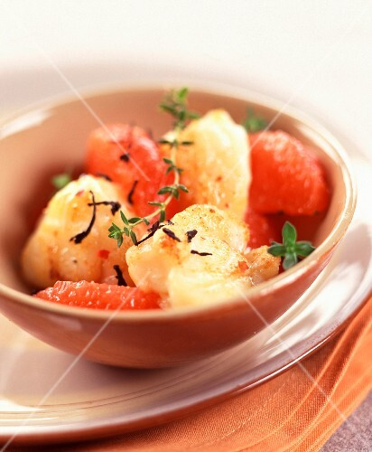 Small pieces of monkfish in grapefruit and tea sauce