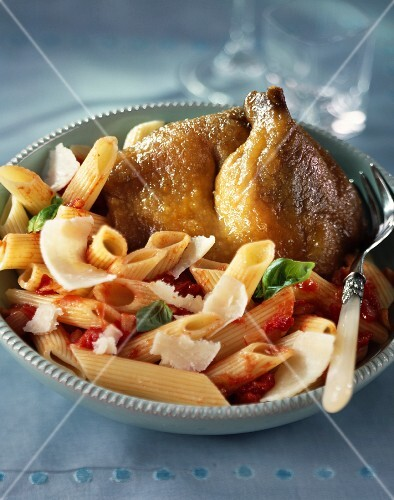 Preserved duck and pasta with tomato sauce and parmesan