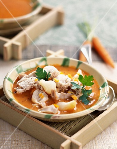 Carrot soup with rabbit and orange