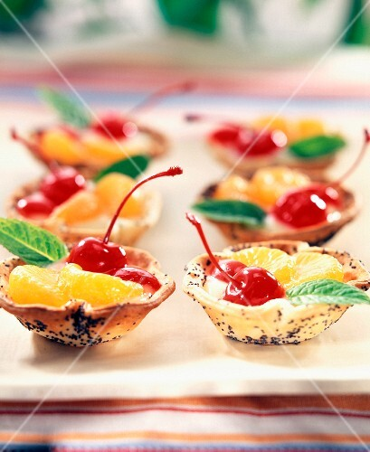 Individual cherry and clementine tarts
