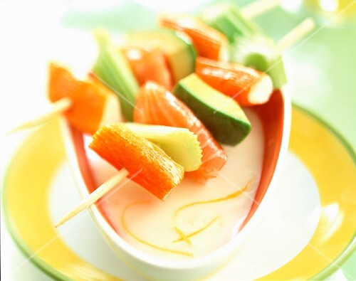marinated salmon and raw vegetable skewers with yoghurt sauce
