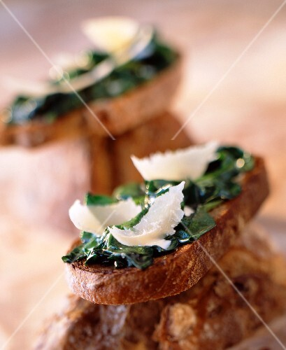 Spinach shoots and parmesan on bread