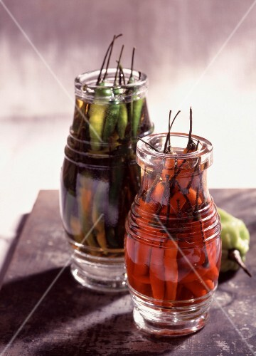 Jars of chili peppers in whiskey