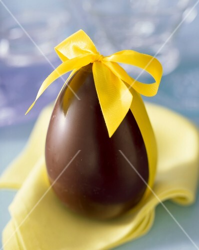 Chocolate Easter egg with yellow ribbon