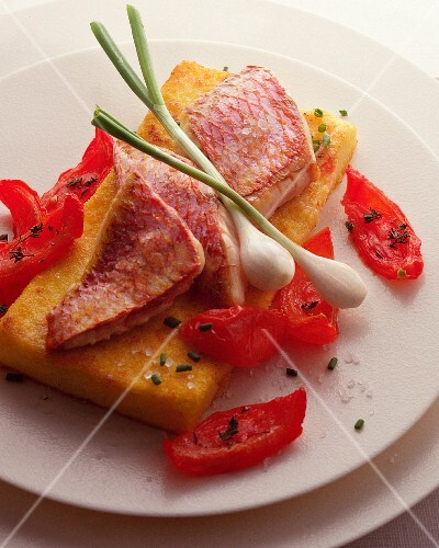 Red mullet on bread with confit tomatoes